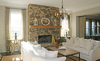 decoration-stacked-stone-fireplace-in-the-modern-living-room-with-white-sofa-set-and-chandelier-and-wooden-flooring-and-white-color-of-wall-and-ceiling-paint-build-a-country-stacked-dry-stone-fireplace-s