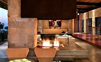 Exotic-Open-Fireplace-Living-Room-Design-with-Natural-Stone-and-Fireplace-from-C.Ware-Inc